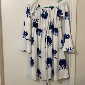 White dress with blue floral detail